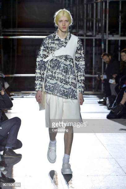 A model walks the runway at the Comme Des Garcons Homme Plus Autumn Winter 2018 fashion show during Paris Menswear Fashion Week on January 19 2018 in...