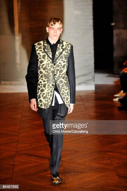 A model walks the runway at the Comme Des Garcons Homme Plus fashion show during Paris Fashion Week Menswear Autumn/Winter 2009 on January 23 2009 in...