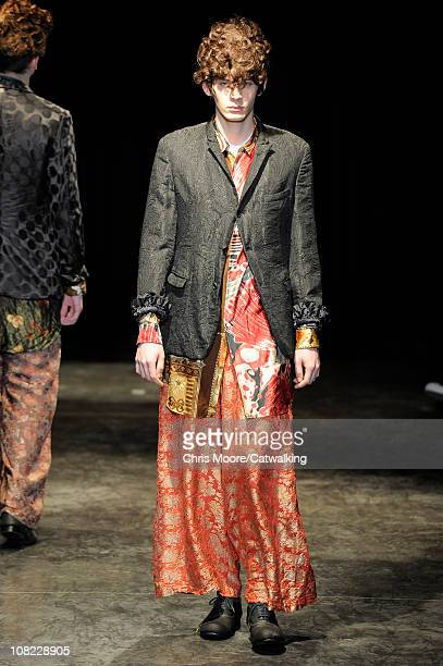 A model walks the runway at the Comme des Garcons Homme Plus menswear fashion show during Paris Fashion Menswear Week on January 21 2011 in Paris...