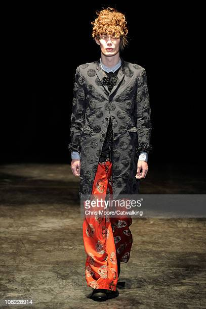 Model walks the runway at the Comme des Garcons Homme Plus menswear fashion show during Paris Fashion Menswear Week on January 21, 2011 in Paris,...