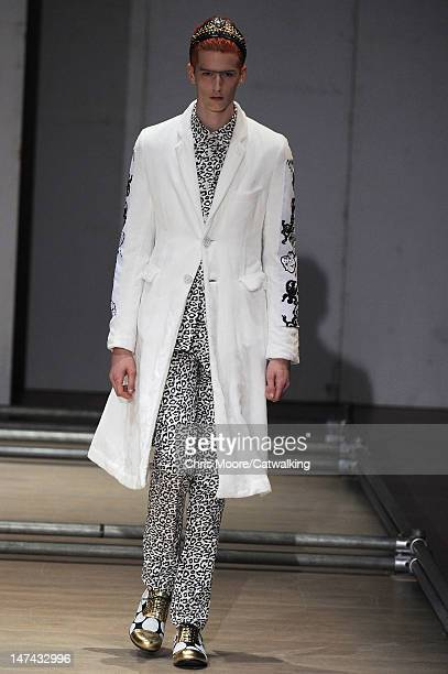 A model walks the runway at the Comme Des Garcons Homme Plus Spring Summer 2013 fashion show during Paris Menswear Fashion Week on June 29 2012 in...