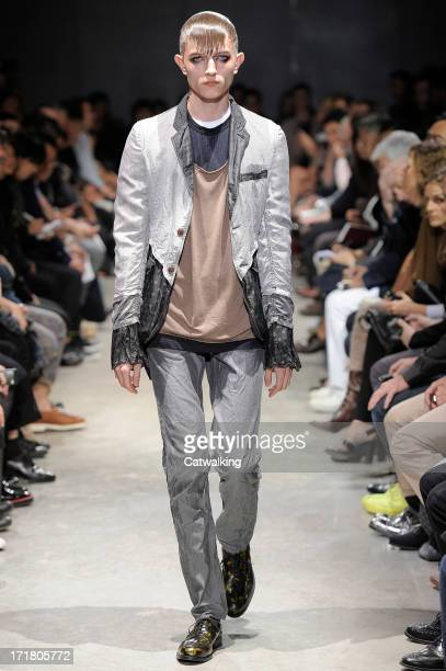 Model walks the runway at the Comme Des Garcons Homme Plus Spring Summer 2014 fashion show during Paris Menswear Fashion Week on June 28, 2013 in...