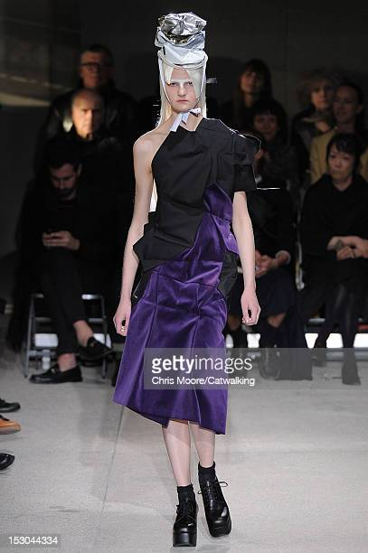 Model walks the runway at the Comme Des Garcons Spring Summer 2013 fashion show during Paris Fashion Week on September 29, 2012 in Paris, France.