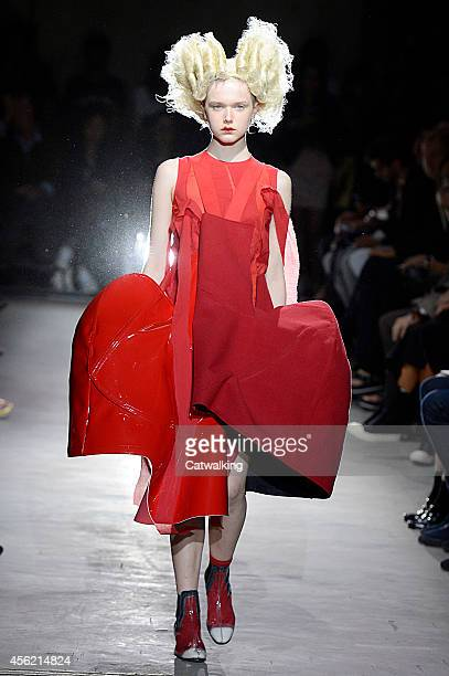 Model walks the runway at the Comme Des Garcons Spring Summer 2015 fashion show during Paris Fashion Week on September 27, 2014 in Paris, France.