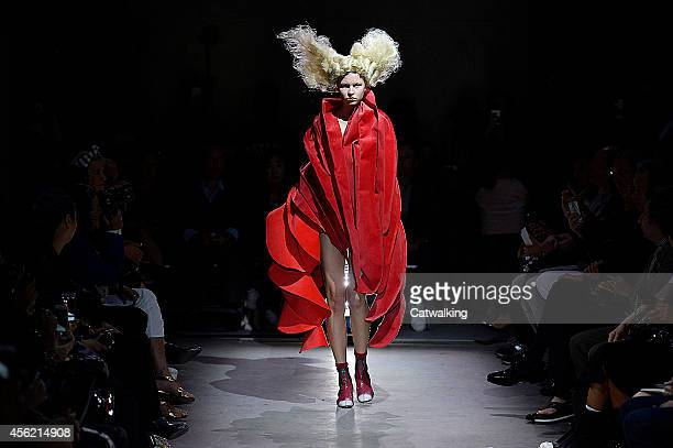 A model walks the runway at the Comme Des Garcons Spring Summer 2015 fashion show during Paris Fashion Week on September 27 2014 in Paris France