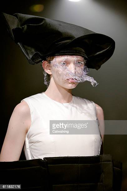 Model walks the runway at the Comme des Garcons Spring Summer 2017 fashion show during Paris Fashion Week on October 1, 2016 in Paris, France.