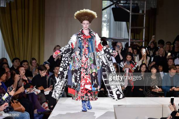 A model walks the runway at the Comme Des Garcons Spring Summer 2018 fashion show during Paris Fashion Week on September 30 2017 in Paris France