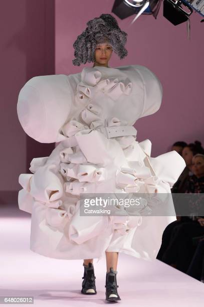 A model walks the runway at the Commes Des Garcons Autumn Winter 2017 fashion show during Paris Fashion Week on March 4 2017 in Paris France