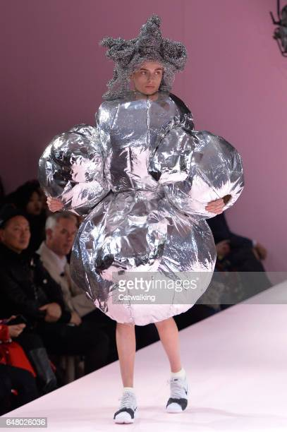 Model walks the runway at the Commes Des Garcons Autumn Winter 2017 fashion show during Paris Fashion Week on March 4, 2017 in Paris, France.