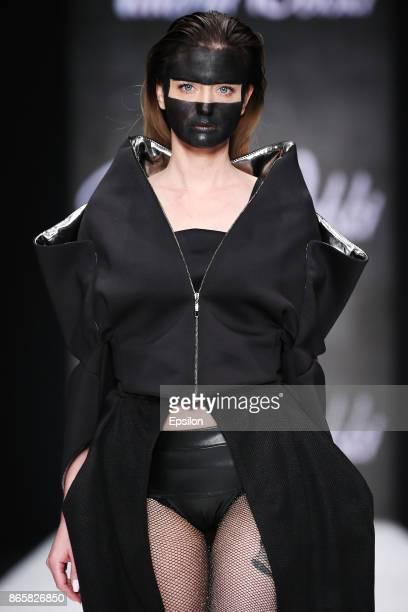 A model walks the runway at the CONTRFASHION Nata Gamurar TataPolina and Dima Kamma Valeria Delski fashion show during day four of Mercedes Benz...