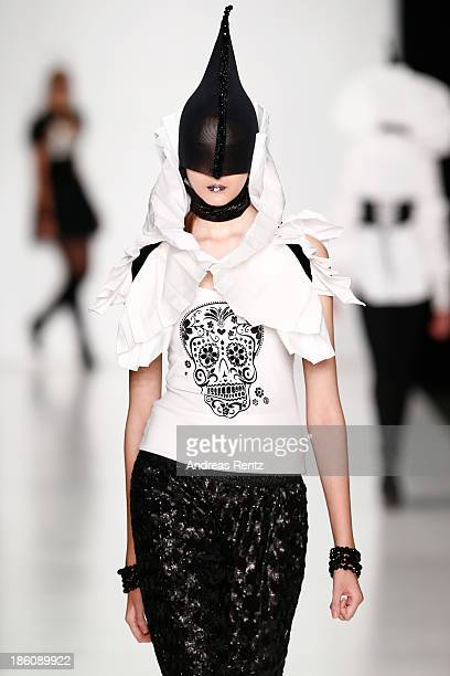 A model walks the runway at the Contrfashion show during MercedesBenz Fashion Week Russia S/S 2014 on October 28 2013 in Moscow Russia