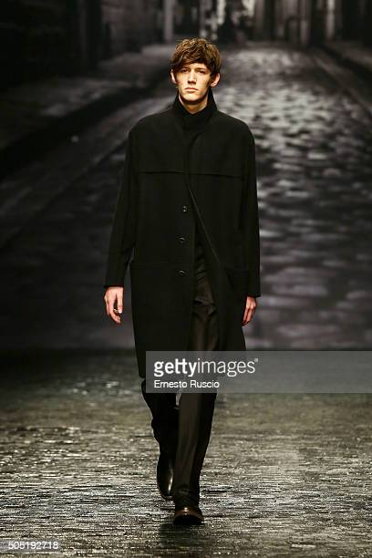 A model walks the runway at the Corneliani show during Milan Men's Fashion Week Fall/Winter 2016/17 on January 16 2016 in Milan Italy