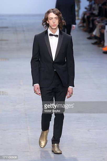 A model walks the runway at the Costume National Homme show during Milan Menswear Fashion Week Spring Summer 2014 on June 22 2013 in Milan Italy