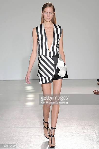 Model walks the runway at the Costume National Spring Summer 2013 fashion show during Paris Fashion Week on September 30, 2012 in Paris, France.