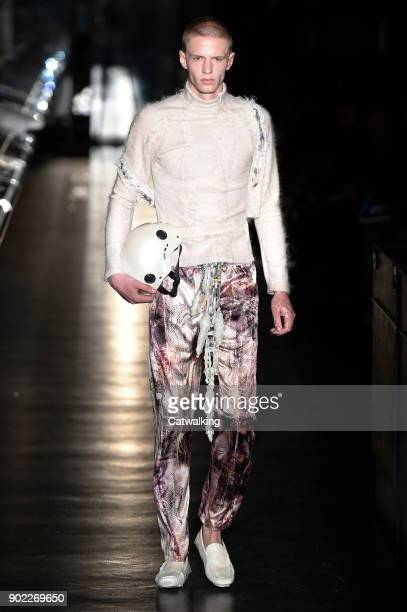 Model walks the runway at the Cottweiler Autumn Winter 2018 fashion show during London Menswear Fashion Week on January 6, 2018 in London, United...