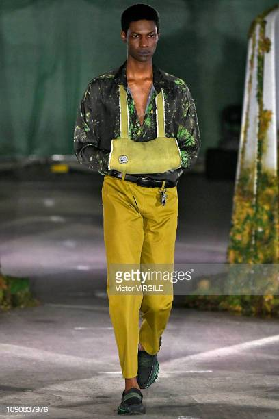 Model walks the runway at the Cottweiler Fall/Winter 2019-2020 fashion show during London Fashion Week Men's January 2019 on January 6, 2019 in...