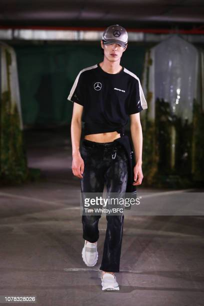 Model walks the runway at the COTTWEILER show during London Fashion Week Men's January 2019 on January 6, 2019 in London, England.