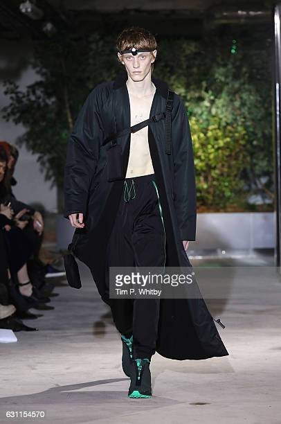 Model walks the runway at the Cottweiler show during London Fashion Week Men's January 2017 collections at 12 Regent Street on January 7, 2017 in...