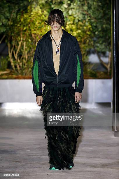 Model walks the runway at the Cottweiler show during London Fashion Week Men's January 2017 collections at BFC Show Space on January 7, 2017 in...