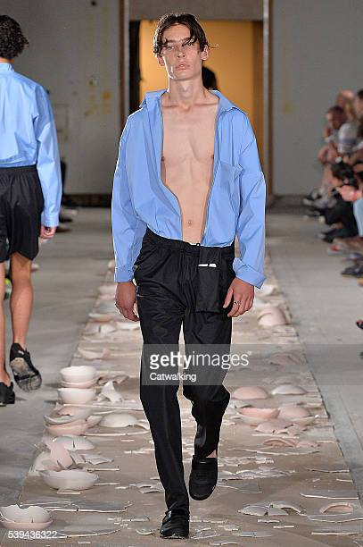 Model walks the runway at the Cottweiler Spring Summer 2017 fashion show during London Menswear Fashion Week on June 11, 2016 in London, United...