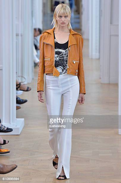 A model walks the runway at the Courreges Spring Summer 2017 fashion show during Paris Fashion Week on September 28 2016 in Paris France