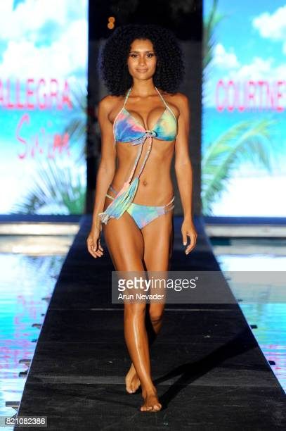A model walks the runway at the Courtney Allegra fashion show during the Art Hearts Fashion at Miami Swim Week at SLS Hyde Beach on July 22 2017 in...