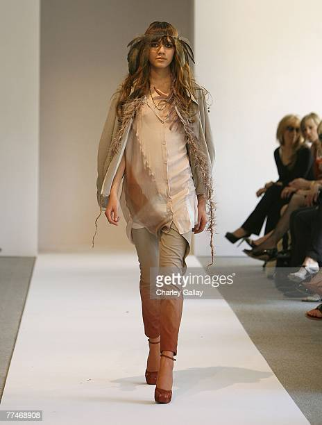 A model walks the runway at the Couture Cares A Benefit for Breast Cancer featuring an outdoor runway presentation of the Nina Ricci Spring/Summer...