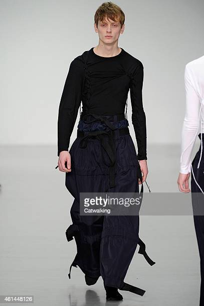 A model walks the runway at the Craig Green Autumn Winter 2015 fashion show during London Menswear Fashion Week on January 12 2015 in London United...
