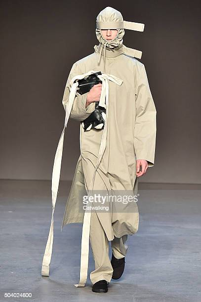 Model walks the runway at the Craig Green Autumn Winter 2016 fashion show during London Menswear Fashion Week on January 8, 2016 in London, United...