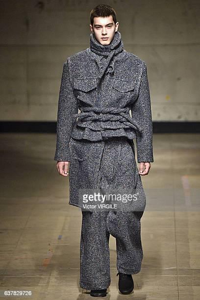 Model walks the runway at the Craig Green Autumn Winter 2017-2018 fashion show during London Menswear Fashion Week on January 6, 2017 in London,...