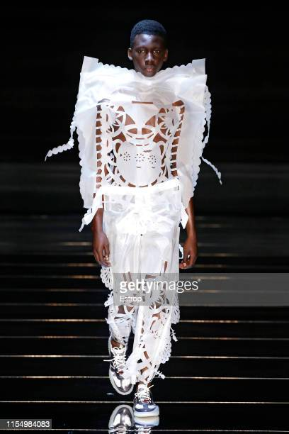 Model walks the runway at the Craig Green fashion show during London Fashion Week Men's June 2019 on June 8, 2019 in London, England.