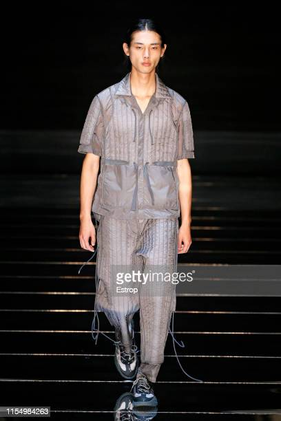 A model walks the runway at the Craig Green fashion show during London Fashion Week Men's June 2019 on June 8 2019 in London England
