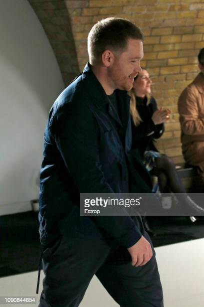 Model walks the runway at the Craig Green show during London Fashion Week Men's January 2019 on January 7, 2019 in London, England.
