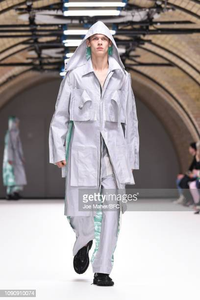 Model walks the runway at the Craig Green show during London Fashion Week Men's January 2019 on January 07, 2019 in London, England.