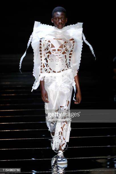 Model walks the runway at the Craig Green show during London Fashion Week Men's June 2019 at The Vaults on June 10, 2019 in London, England.