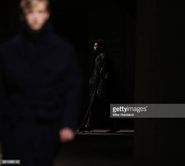 A model walks the runway at the Craig Green show during London Fashion Week Men's January 2017 collections at Topman Show Space on January 6 2017 in...