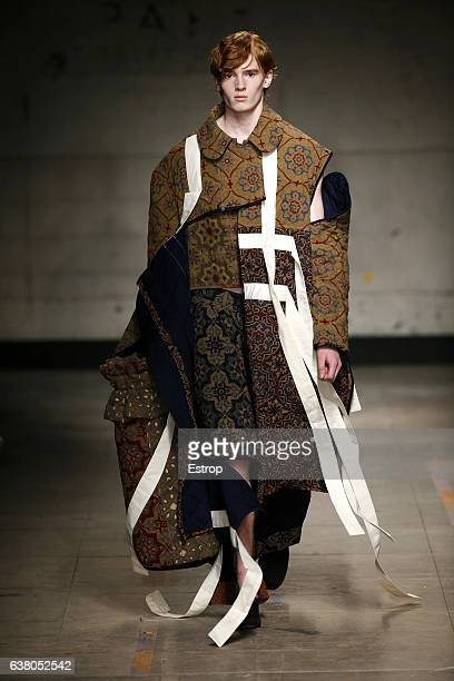 Model walks the runway at the Craig Green show during London Fashion Week Men's January 2017 collections at BFC Show Space on January 6, 2017 in...