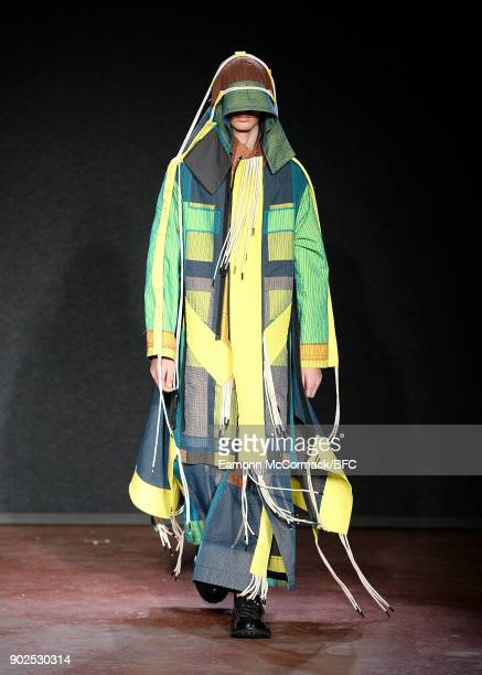 A model walks the runway at the Craig Green show during London Fashion Week Men's January 2018 at The Workshop on January 8 2018 in London England