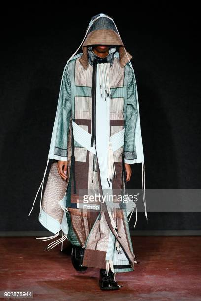 Model walks the runway at the Craig Green show during London Fashion Week Men's January 2018 at on January 8, 2018 in London, England.