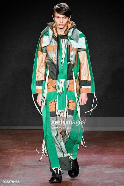 Model walks the runway at the Craig Green show during London Fashion Week Men's January 2018 at The Workshop on January 8, 2018 in London, England.