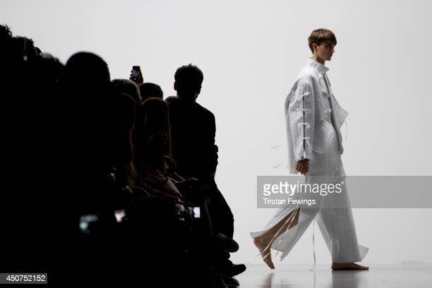 A model walks the runway at the Craig Green show during the London Collections Men SS15 on June 17 2014 in London England
