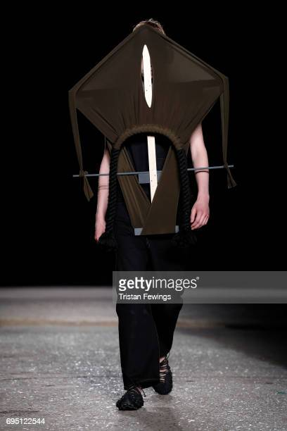 A model walks the runway at the Craig Green show during the London Fashion Week Men's June 2017 collections on June 12 2017 in London England