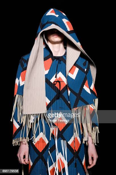 Model walks the runway at the Craig Green show during the London Fashion Week Men's June 2017 collections on June 12, 2017 in London, England.