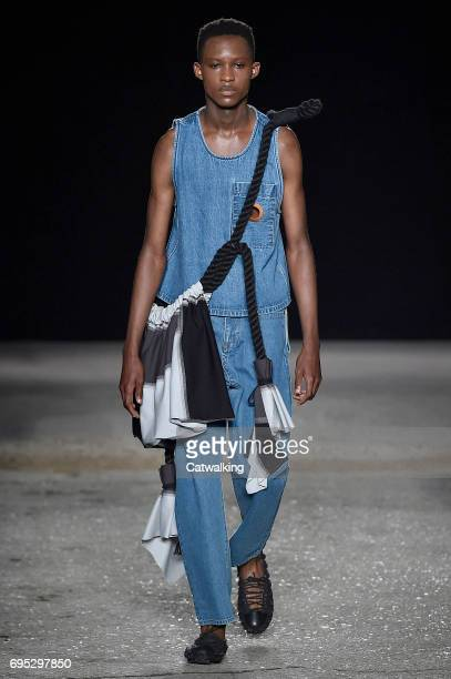 Model walks the runway at the Craig Green Show Spring Summer 2018 fashion show during London Menswear Fashion Week on June 12, 2017 in London, United...