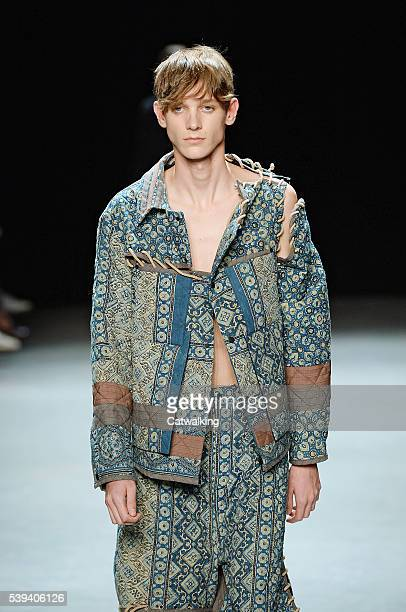 A model walks the runway at the Craig Green Spring Summer 2017 fashion show during London Menswear Fashion Week on June 10 2016 in London United...