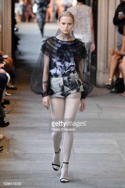 Italian fashion designer Cristiano Burani acknowledges applause following the presentation of his Women's Spring/Summer 2019 fashion show in Milan on...