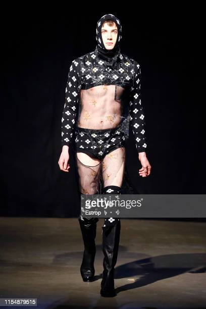 A model walks the runway at the Curtis Wu fashion show during London Fashion Week Men's June 2019 on June 8 2019 in London England