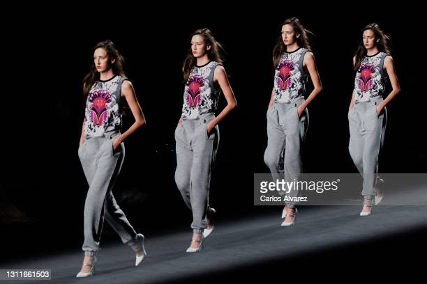 Model walks the runway at the Custo Barcelona fashion show during Mercedes Benz Fashion Week Madrid April 2021 at Ifema on April 09, 2021 in Madrid,...