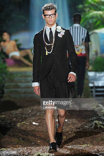 A model walks the runway at the D Squared2 Spring Summer 2014 fashion show during Milan Menswear Fashion Week on June 25 2013 in Milan Italy