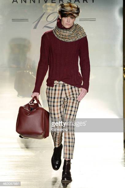 A model walks the runway at the Daks Autumn Winter 2014 fashion show during Milan Menswear Fashion Week on January 12 2014 in Milan Italy